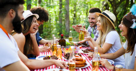 Photo for Friends making barbecue and having lunch in the nature - Royalty Free Image