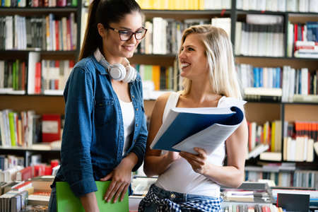 Photo for Group of college students studying in the school library - Royalty Free Image