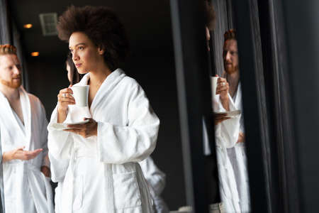 Photo for Woman in bathrobes enjoying tea during wellness weekend - Royalty Free Image