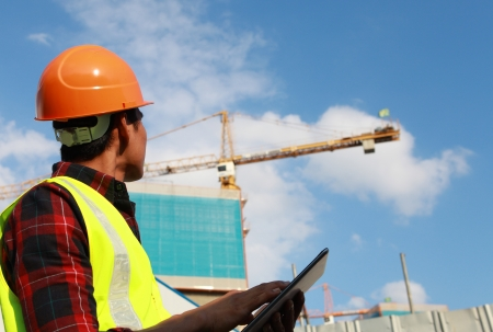 Photo pour builder worker activity with digital tablet on construction site - image libre de droit