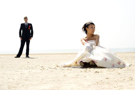 Bride and groom on Silver beach - China