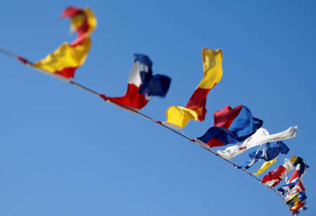 Nautical flags moving in a windy day