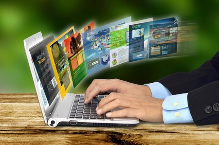 Photo for Businessman hand browsing internet websites on his laptop - Royalty Free Image