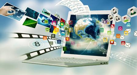 Photo pour A laptop computer with internet connection technology. Sharing multimedia files concept - image libre de droit