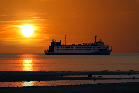 Photo for The ferry sailing at sea episode sunset in gulf of Thailand. - Royalty Free Image