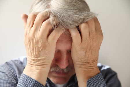 senior man overcome with anxiety, depression or despair