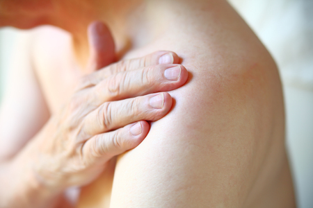 Photo pour Senior man with shoulder joint pain closeup - image libre de droit