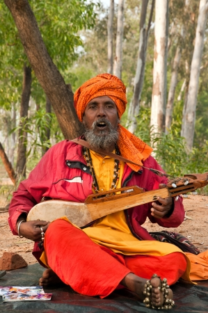 SHANTINIKETAN, INDIA - DECEMBER 22: Traditional baul folk singer performs during the annual Poush Mela fair on December 22, 2012 in Shantiniketan, West Bengal, India.