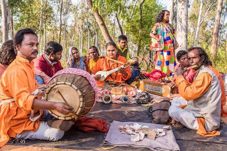 SHANTINIKETAN, INDIA - DECEMBER 26: An Indian traditional baul folk band performs during the annual Poush Mela fair on December 26, 2015 in Shantiniketan, West Bengal, India.