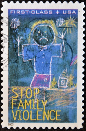 UNITED STATES OF AMERICA - 2003: A stamp printed in the United States of America shows image concerning to end of Family Violence, series, 2003