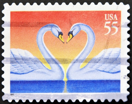 UNITED STATES OF AMERICA - CIRCA 1997: Love Swans stamp printed in the USA, circa 1997