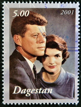 DAGESTAN - CIRCA 2001: A stamp printed in Republic of Dagestan shows John F Kennedy with wife Jacqueline, circa 2001