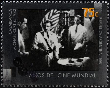 ARGENTINA - CIRCA 1995: A stamp printed in Argentina dedicated to 100 years of world cinema shows Casablanca scene of Michael Curtiz, circa 1995