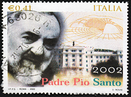 GRANADA, SPAIN - NOVEMBER 30, 2015: A stamp printed in Italy shows Pio of Pietrelcina , 2002