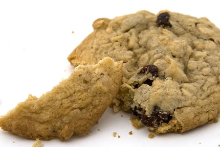It's an oatmeal raisin cookie that has had a bit of torn off, with crumbs scattered about.