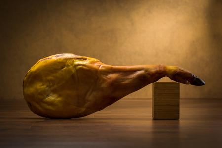 Iberian Ham isolated on wood background