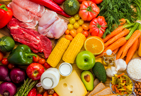 Photo pour Different types of food from the food pyramid seen from above. - image libre de droit