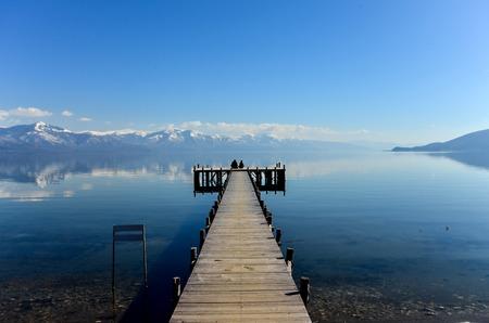 Photo pour Pivture of a Romance on a pier of Lake Prespa, Macedonia - image libre de droit