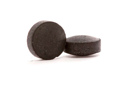 picture of a activated coal tablets isolated on white