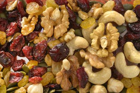 Photo pour mixed nuts with raisins close up shoot on wooden background - image libre de droit