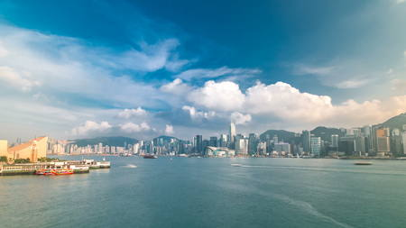Photo for Hong Kong Harbor panorama cityscape timelapse with blue cloudy sky - Central District, Victoria Harbor, Victoria Peak, Hong Kong Island and Kowloon, Hong Kong. Wide angle view. 4K - Royalty Free Image