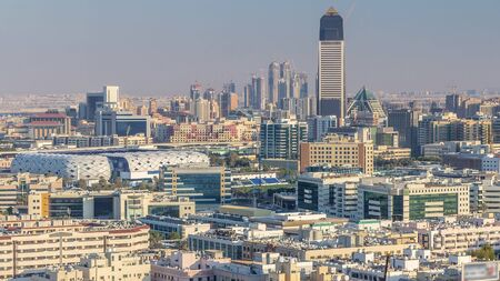 Photo pour Aerial view of neighbourhood Deira and Dubai creek with typical old and modern buildings timelapse. Stadium and skyscrapses. View from skyscraper rooftop. Dubai, United Arab Emirates - image libre de droit
