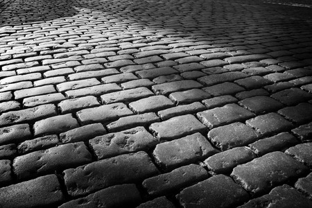 Photo for Cobblestone background with long shadows at sunset, London - Royalty Free Image