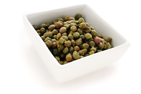 caper berries isolated on white