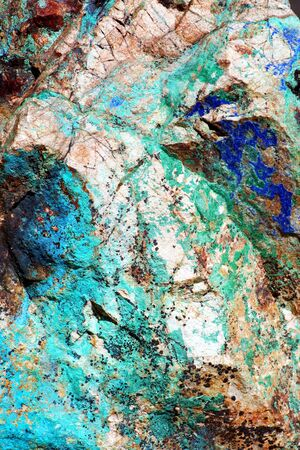 A close-up look at the intense greens and blues of malachite and azurite in Arizona's copper ore deposits.