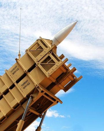 A Patriot Missile Poised in its Launcher Against a Cloudy Sky