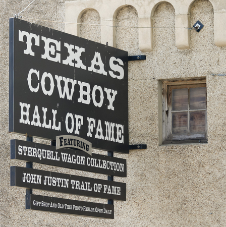 Foto für FORT WORTH, TEXAS, MARCH 15. The Texas Cowboy Hall of Fame on March 15, 2017, in Fort Worth, Texas. A Sterquell Wagon Collection at the Texas Cowboy Hall of Fame Sign in the Fort Worth Stockyards in Fort Worth, Texas. - Lizenzfreies Bild