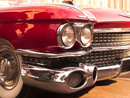 chrome radiator grill of red american classic car