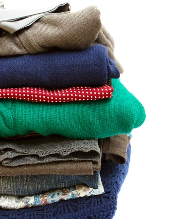 pile of multicolored clothes on white background