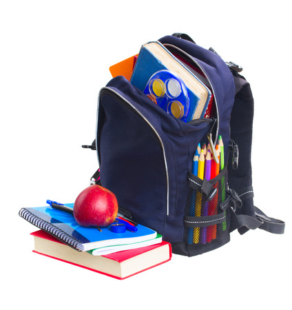 blue school backpack full of  stationery  isolated on white background