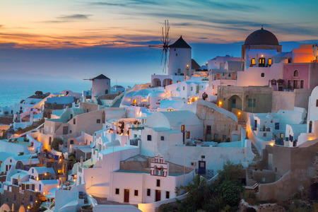 lights of Oia village at night, Santorini, Greece