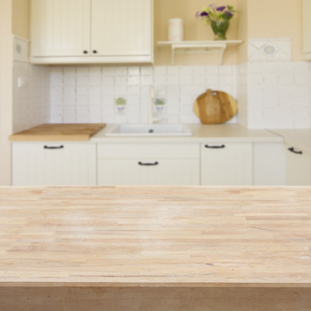 wooden table  in a light modern kitchen