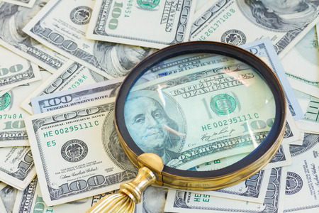 money under manifying glass