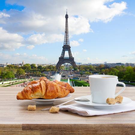 Foto de cup of coffee with croissant in Paris, France - Imagen libre de derechos