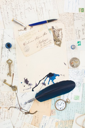 old mails background with vintage watch, feather pen,  and key, copy space on old  papers