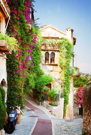 beautiful old town street of Provence at summer day, France, retro toned