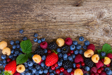 pile  of fresh  berries mix on wood, top view