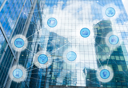 Foto de skyscrapers and wireless communication network, IoT Internet of Things and ICT Information Communication Technology concept - Imagen libre de derechos