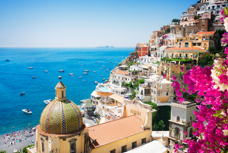 view of Positano with flowers - famous old italian resort, Italy