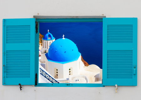 Photo for view of classical church with blue domes through window, Oia, Santorini, Greece - Royalty Free Image