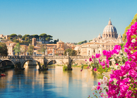 Photo pour St. Peters cathedral over bridge and river with summer flowers in Rome, Italy , toned image - image libre de droit