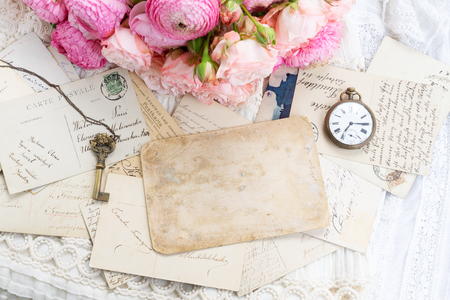 Photo for Pink and white roses and ranunculus with antique clock and skeletone key, copy space on vintage letter - Royalty Free Image