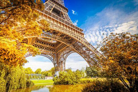 Photo pour Paris famous landmarks. Eiffel Tower in fall park, Paris France - image libre de droit