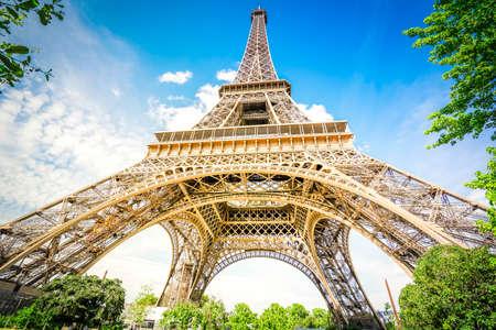 Photo pour Paris famous landmarks. Eiffel Tower in blue sky, view upside down, Paris France with sunshine - image libre de droit