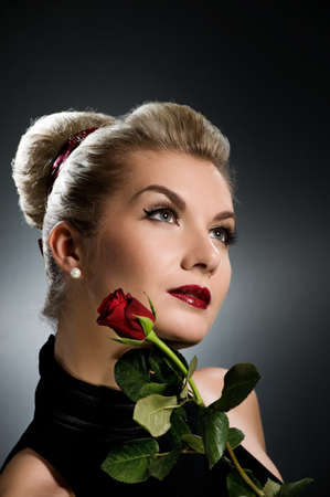 Charming lady with red rose