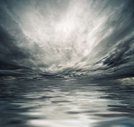 Dramatic sky reflected in sea water